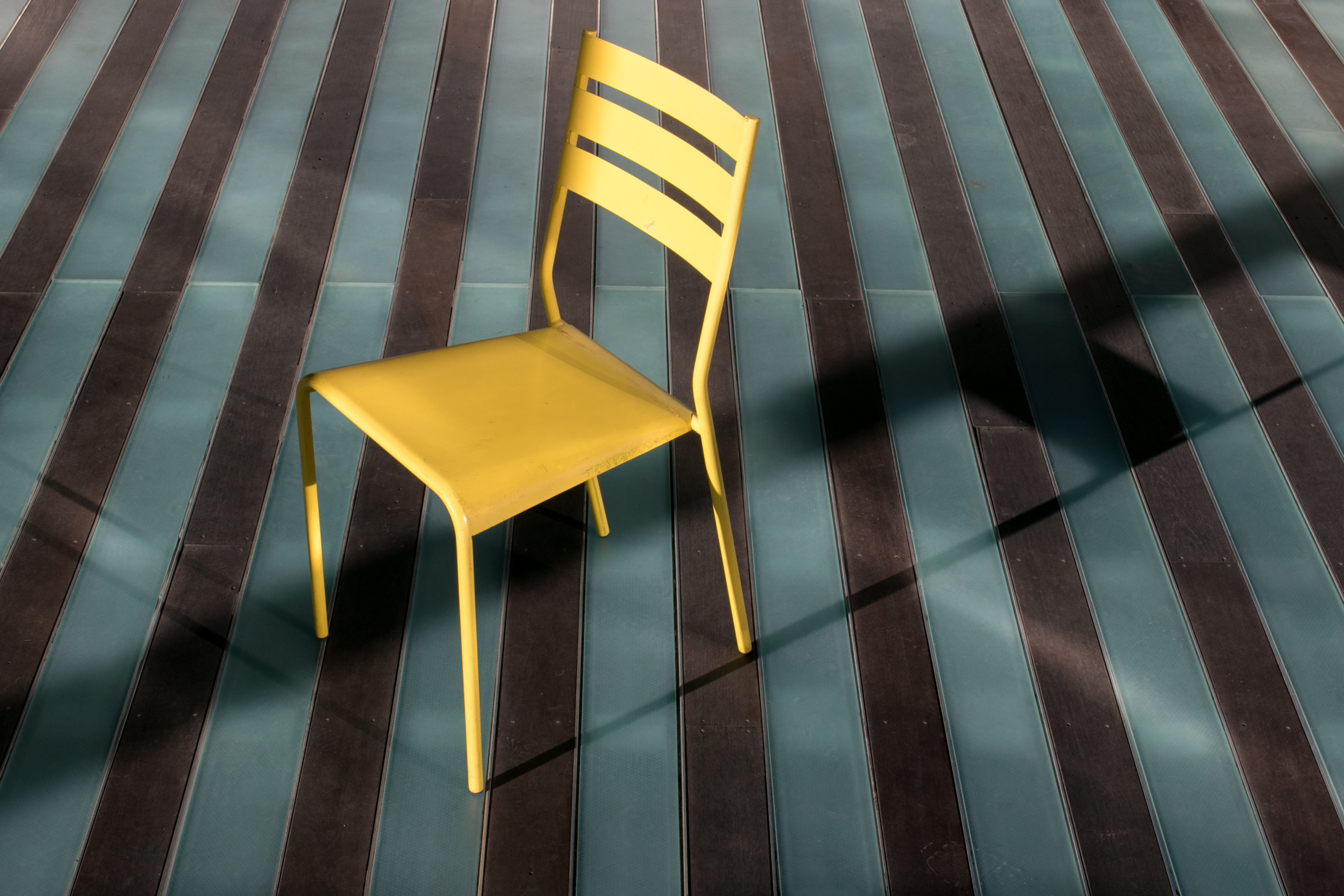 two yellow and gray wooden chairs