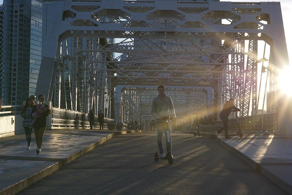 man using balance board on bridge