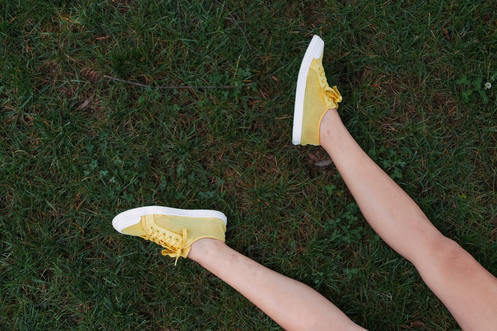 yellow-and-white low-top sneakers