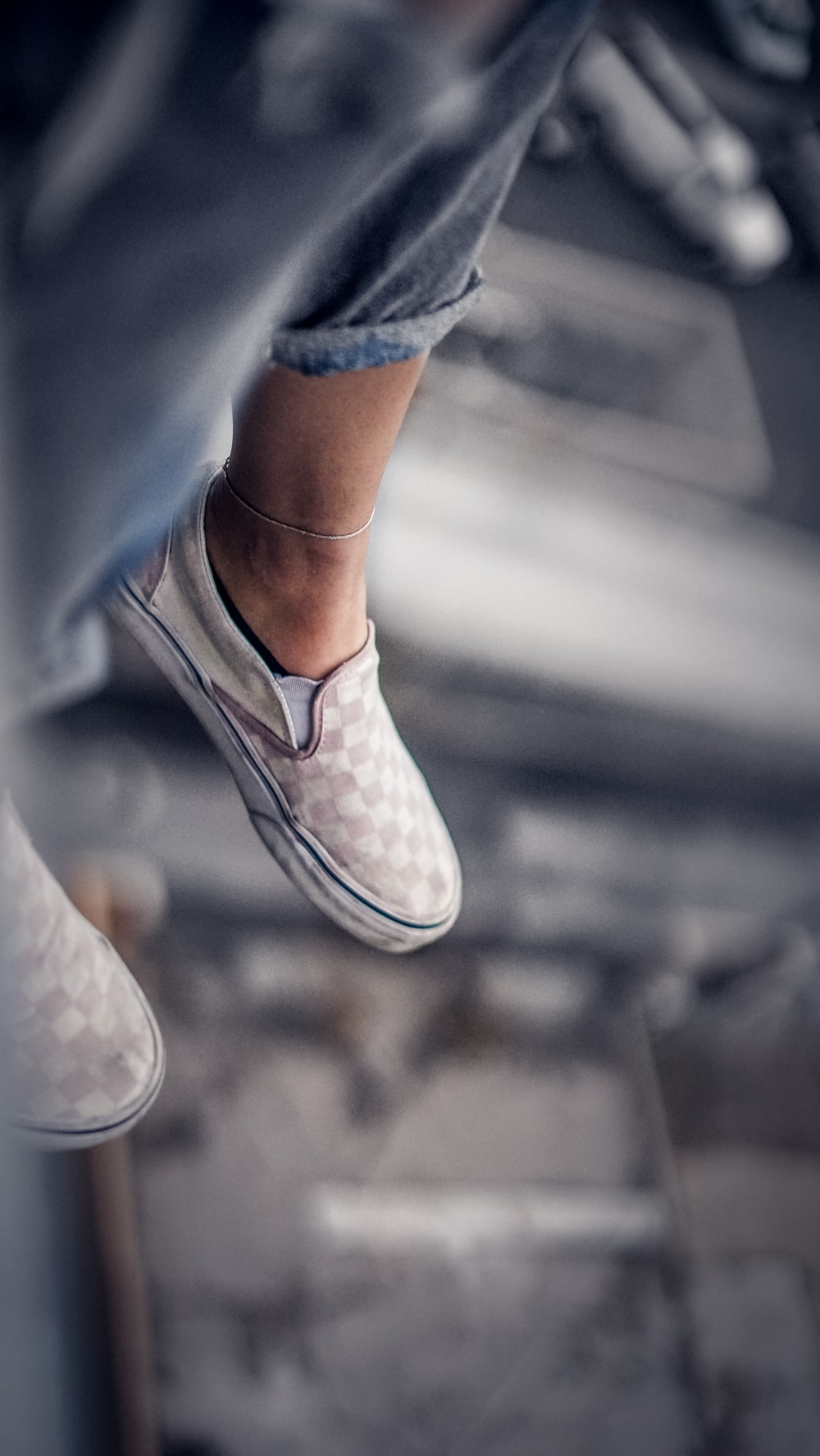 pair of gray and white Vans sneakers