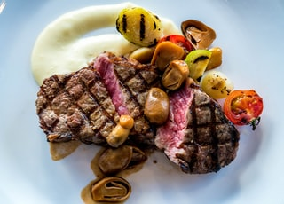 steak with grilled mushroom, tomato, and potato toppings
