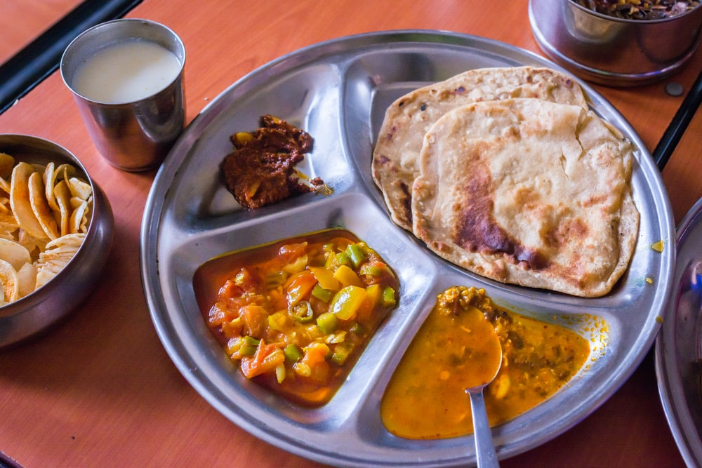 cooked food on round tray