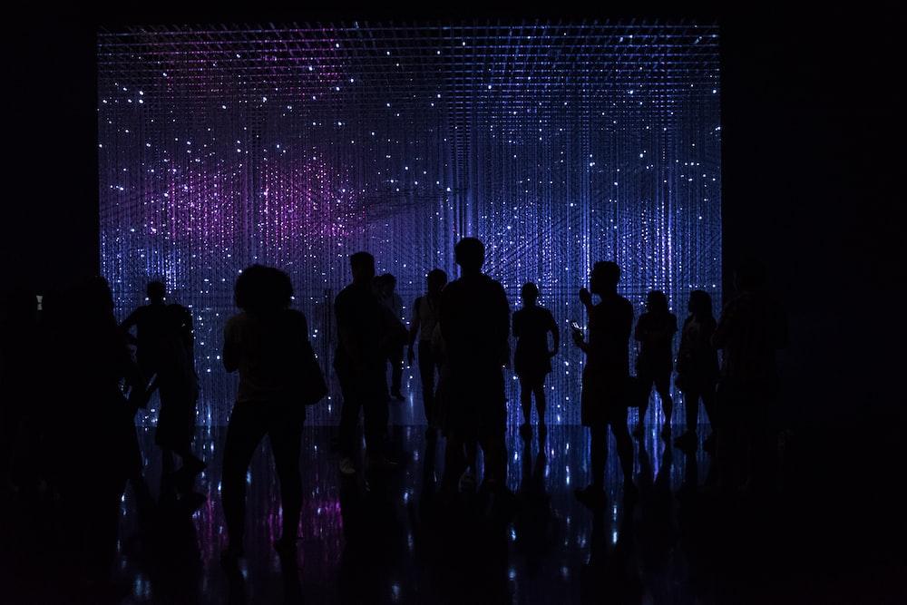 silhouette of people inside a dark room
