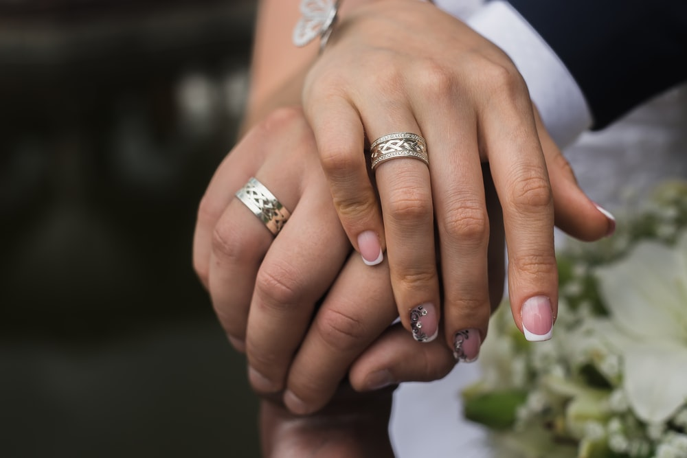 silver-colored wedding rings