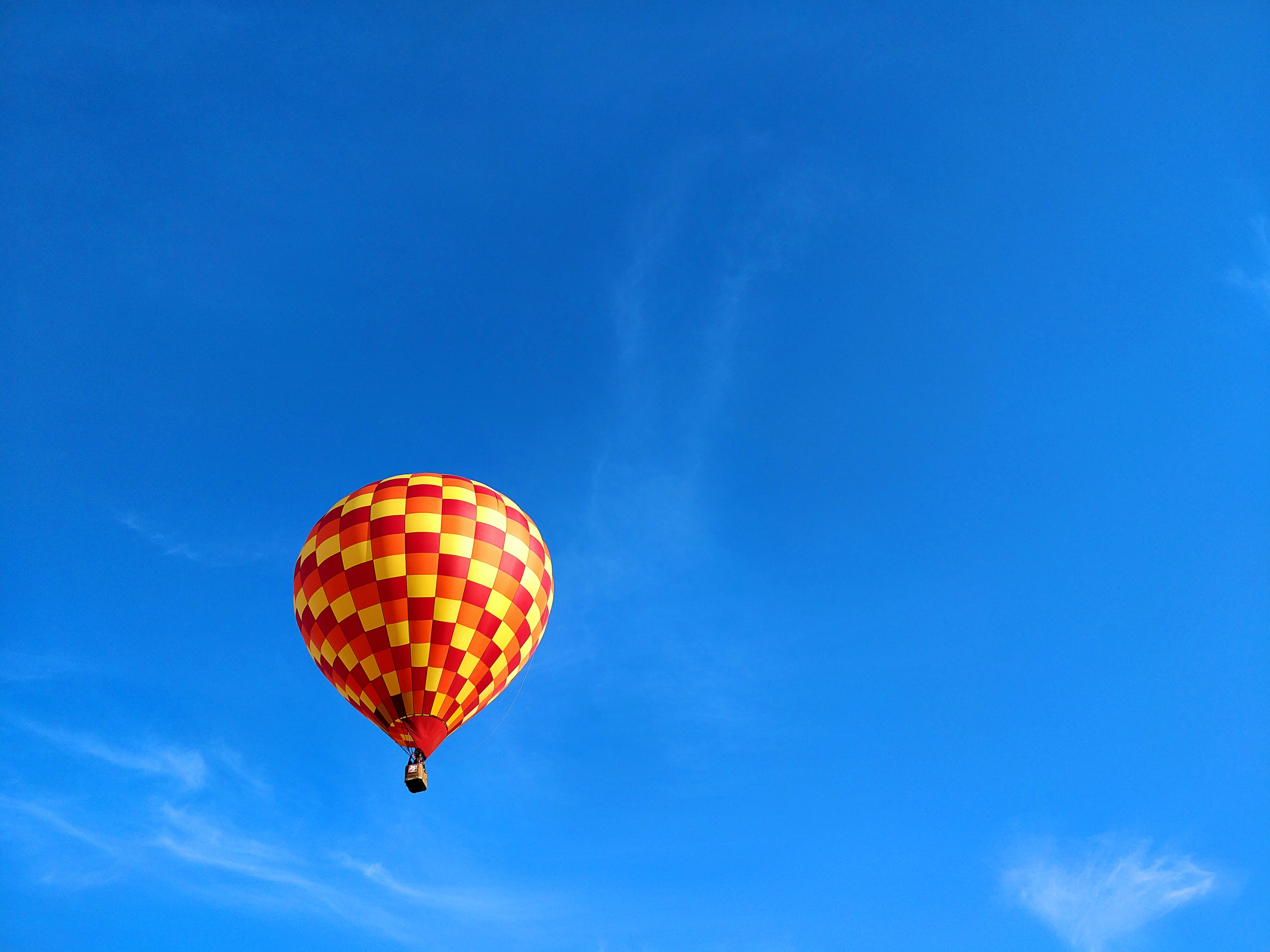 red and yellow checkered hot air balloon