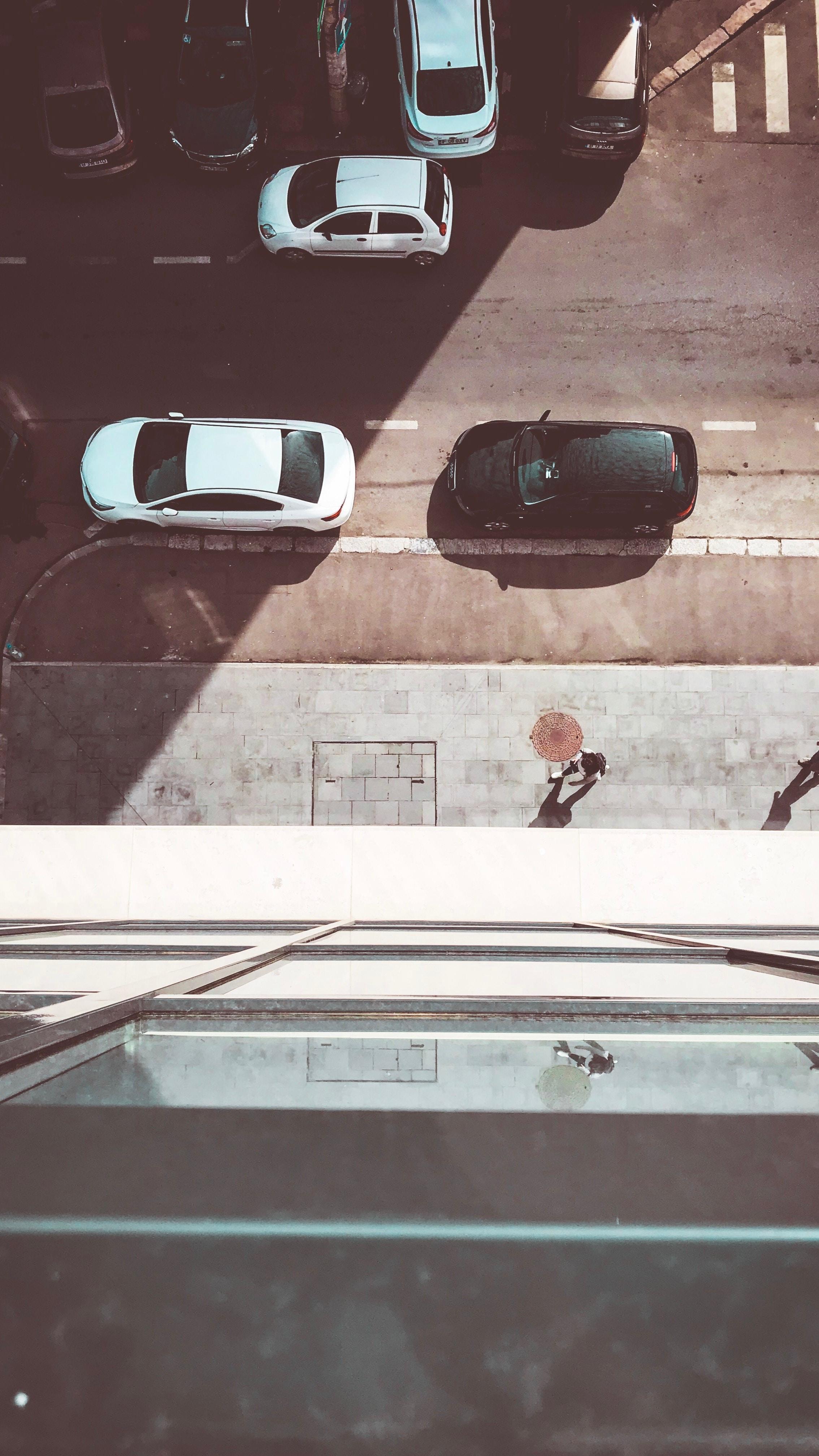 black car front of white car