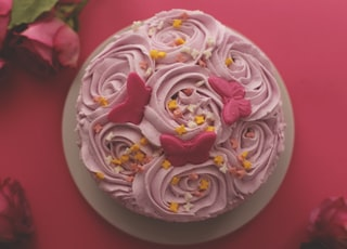 flat-lat photography of pink-icing colored rosette cake