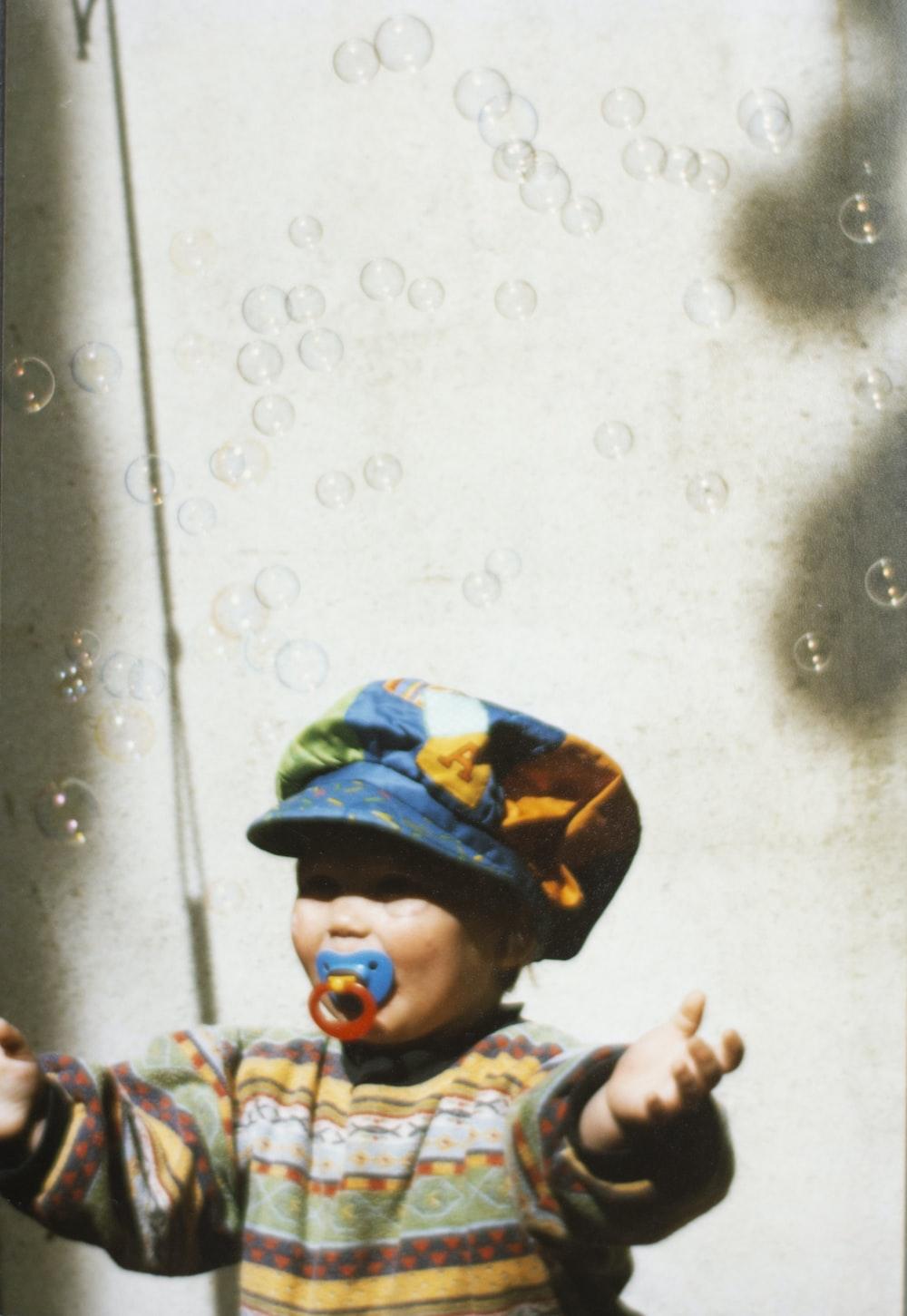 toddler standing near wall