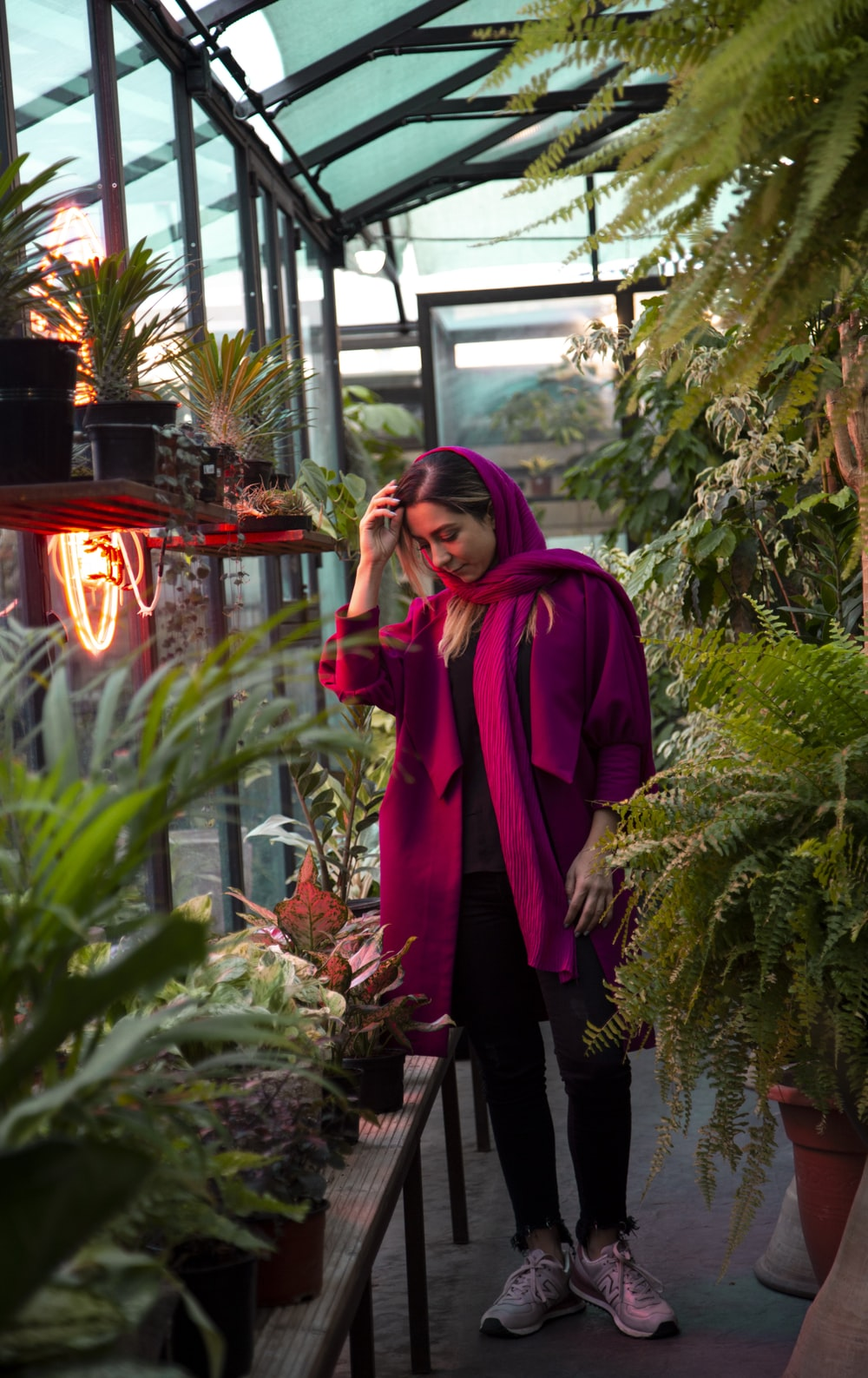 woman standing inside plant builidng