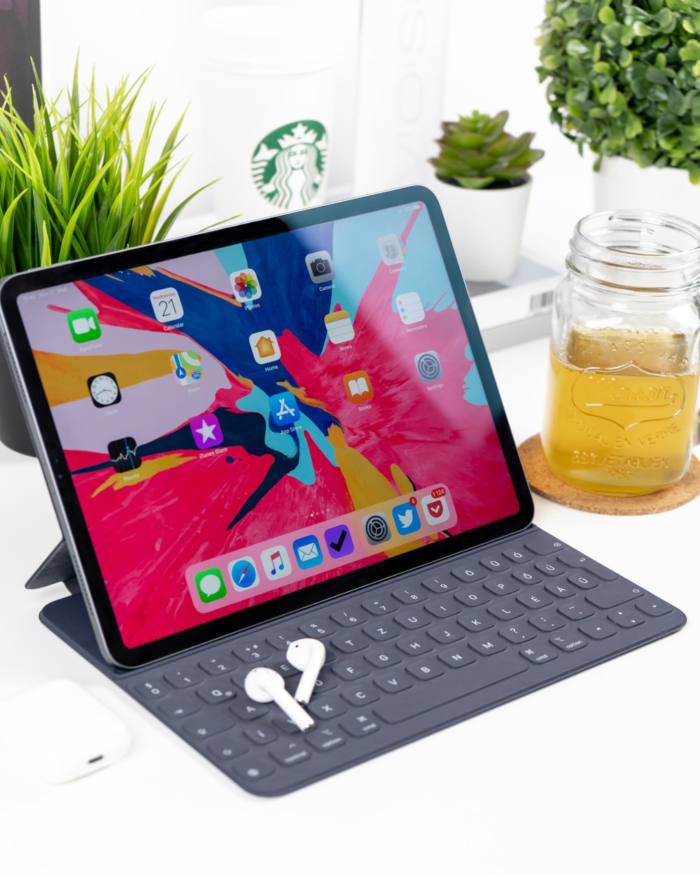 turned-on black tablet computer with keyboard