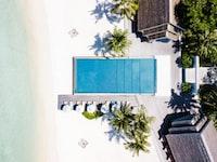 rectangular white swimming pool during daytime