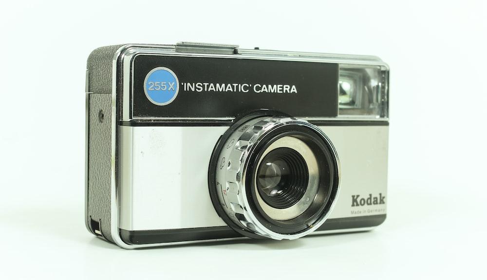 gray and black Kodak Instamatic camera