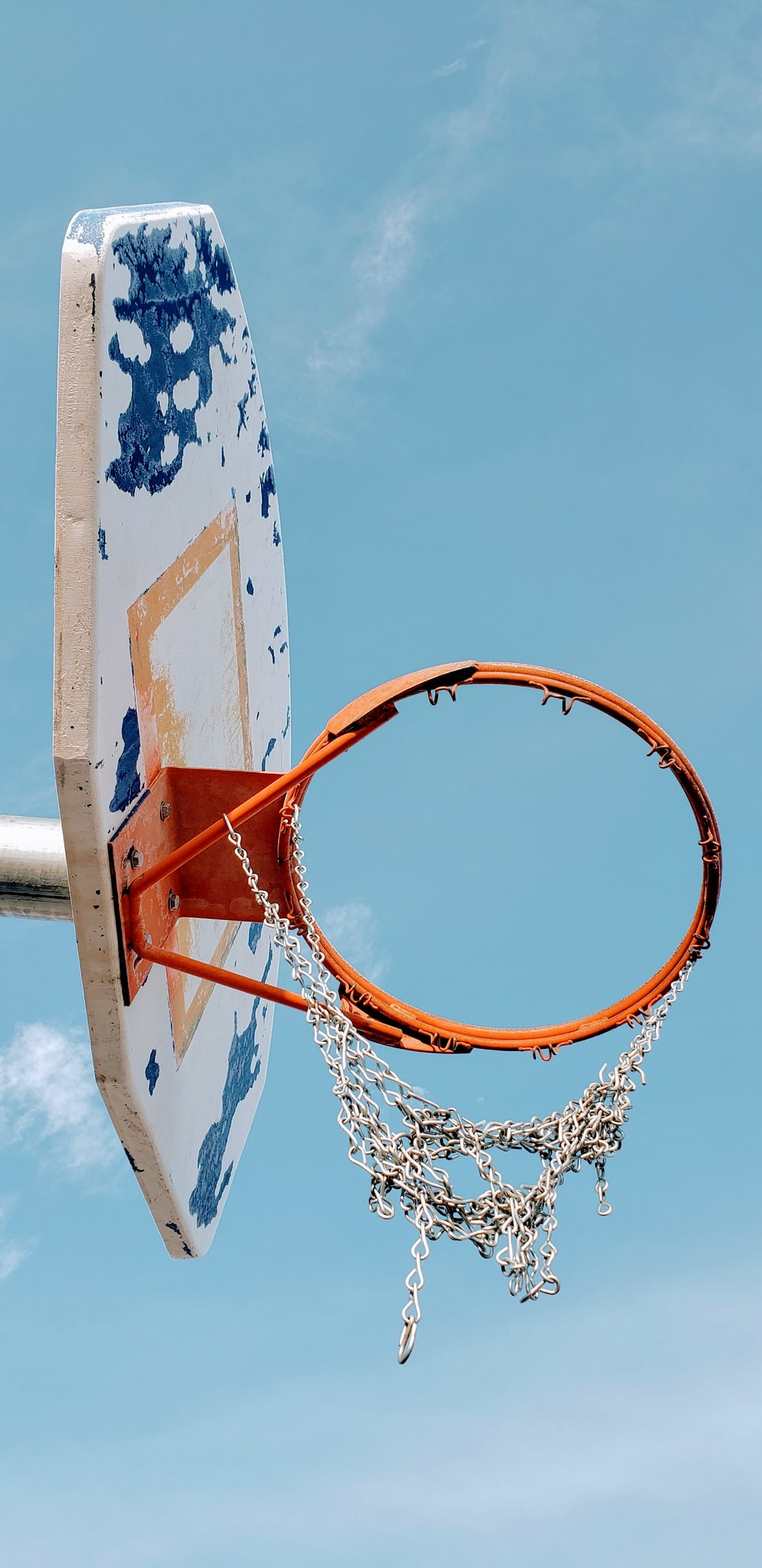 white and blue portable hoop under blue sky