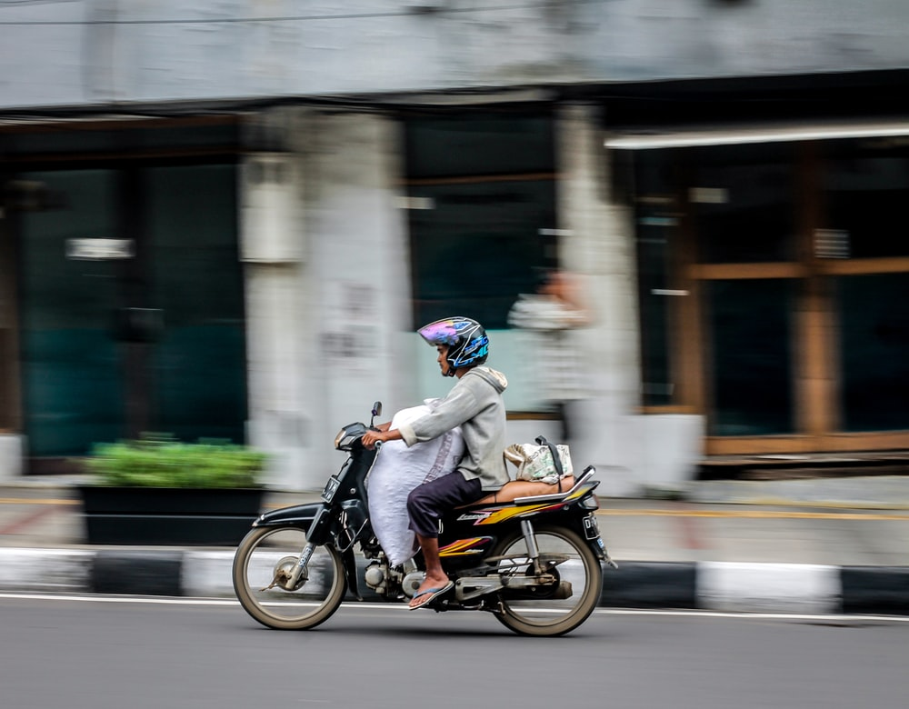 time lapse man driving motorcycle