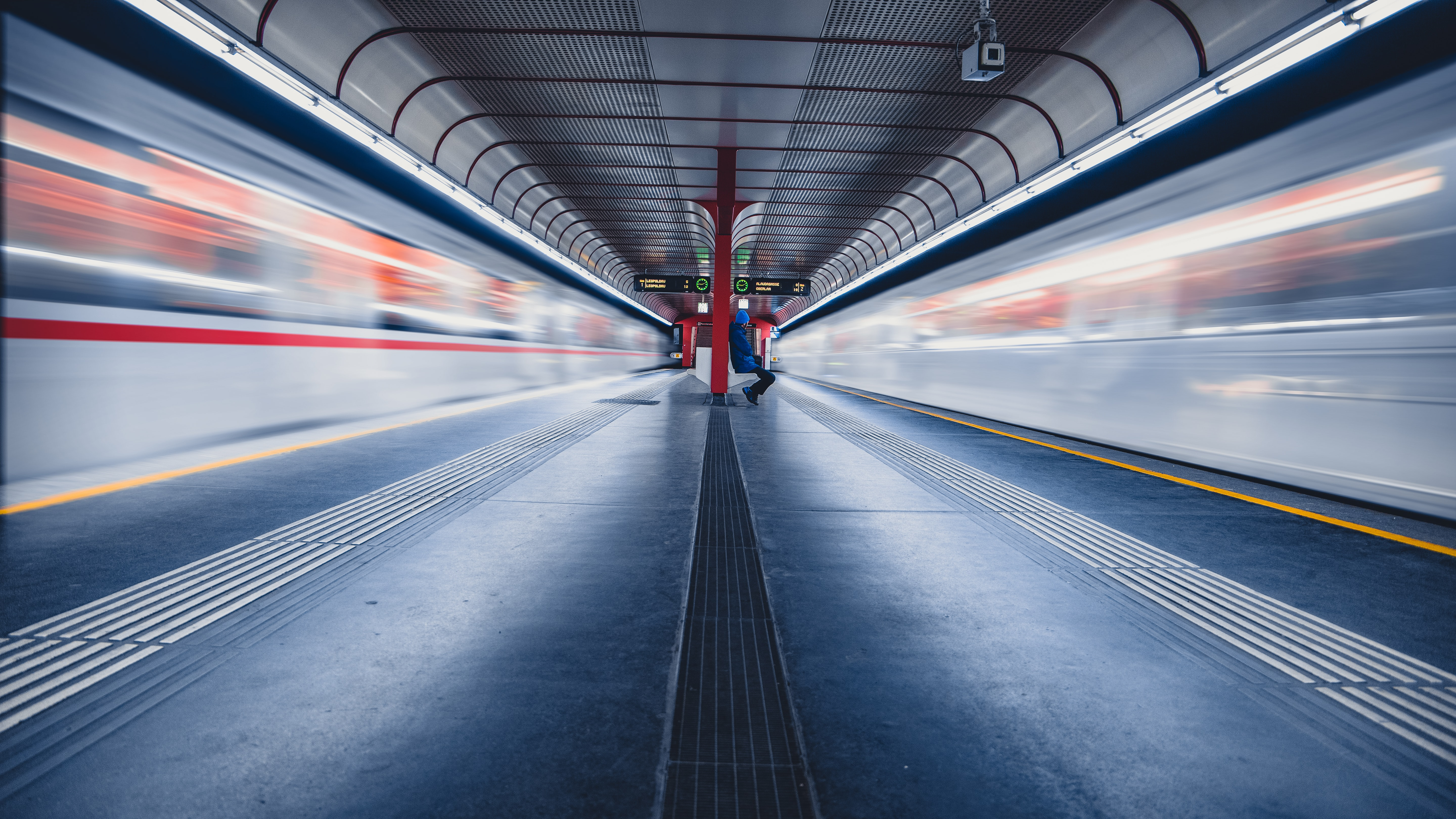 time lapse photography of trains in train station
