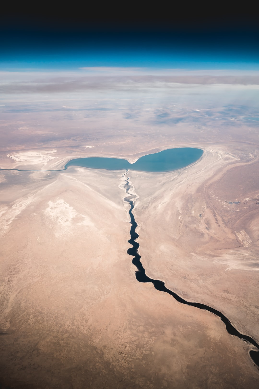 40 years ago it was the fourth largest lake in the world. Now, only a few puddles are left. Like this mini-lake that looks like a bleeding out heart. Sad view out of my airplane window.