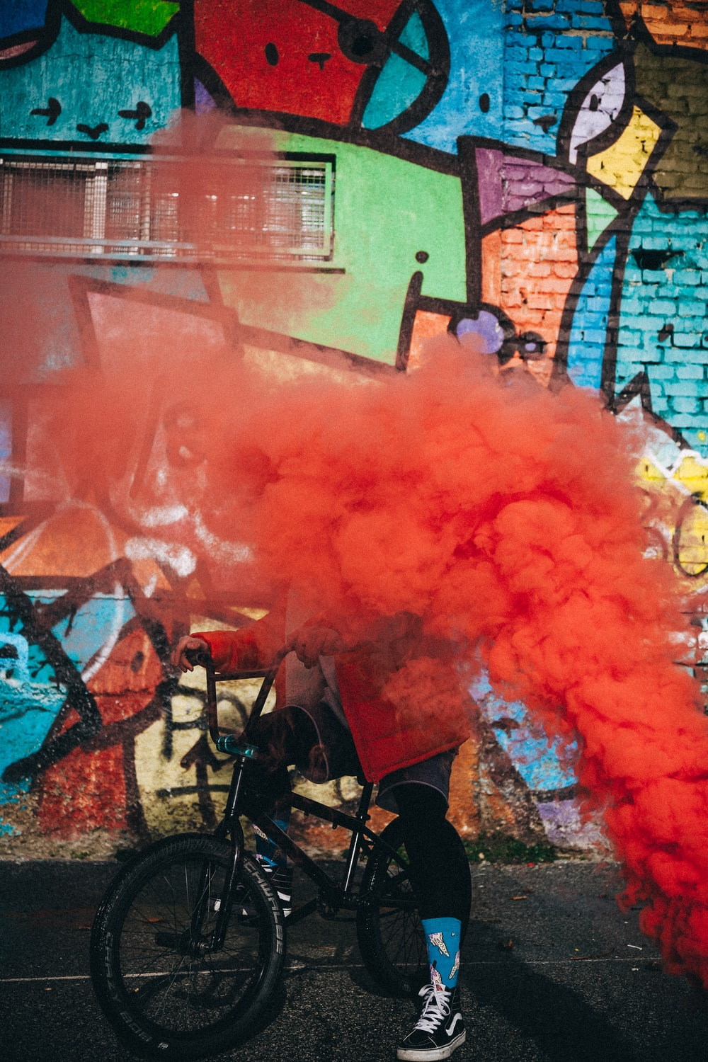 red smoke going towards person on bike