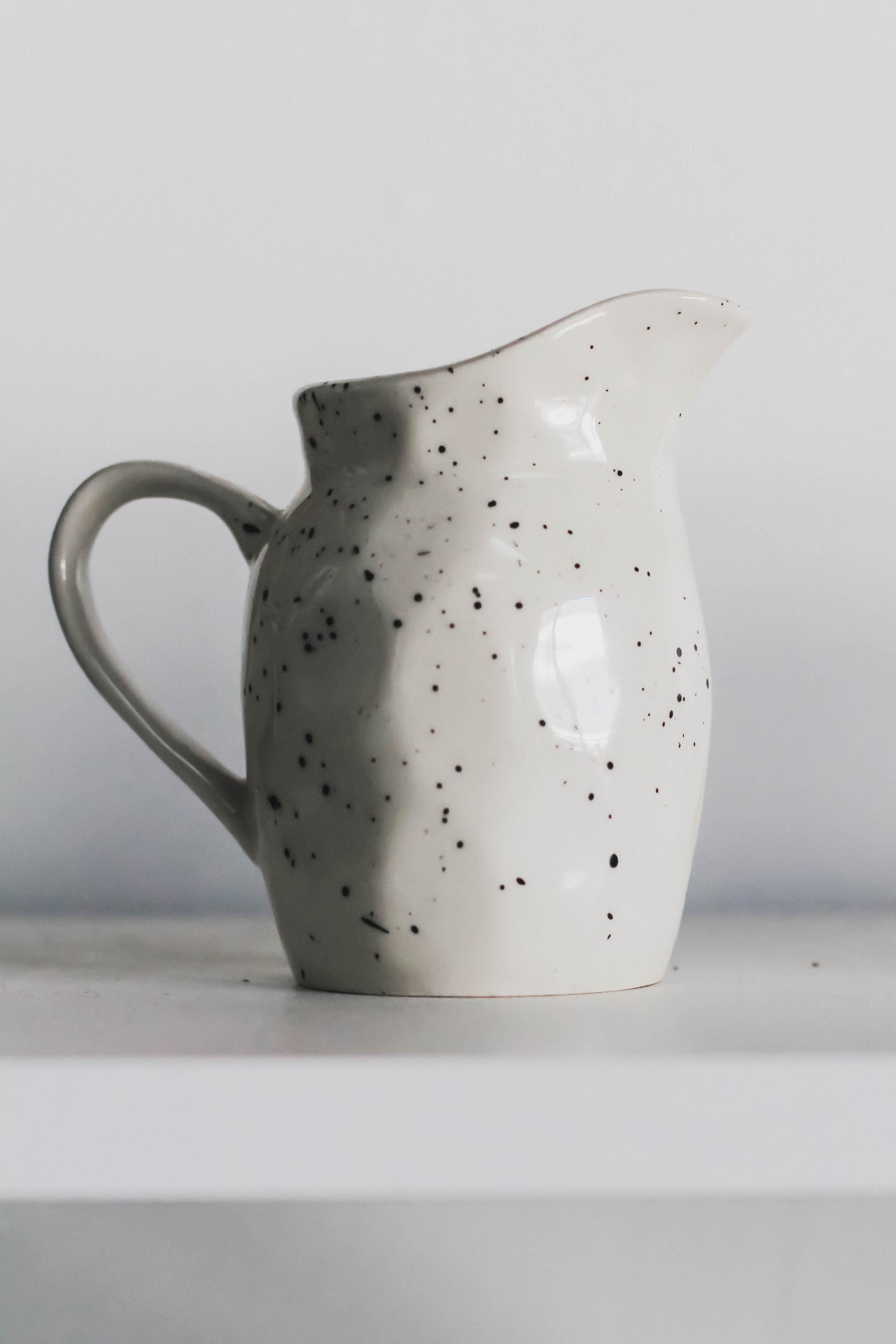 white and black polka dot print textile