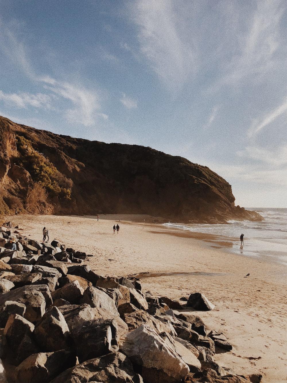 gray rocks beside seashores across mountain
