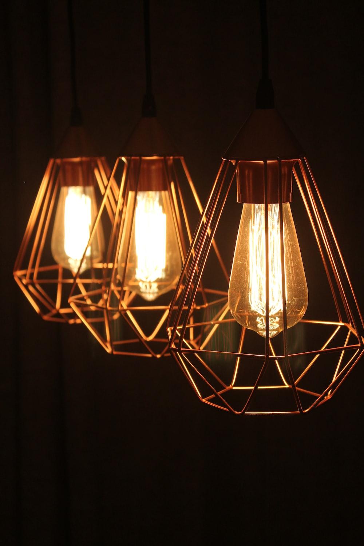 three lighted sconces