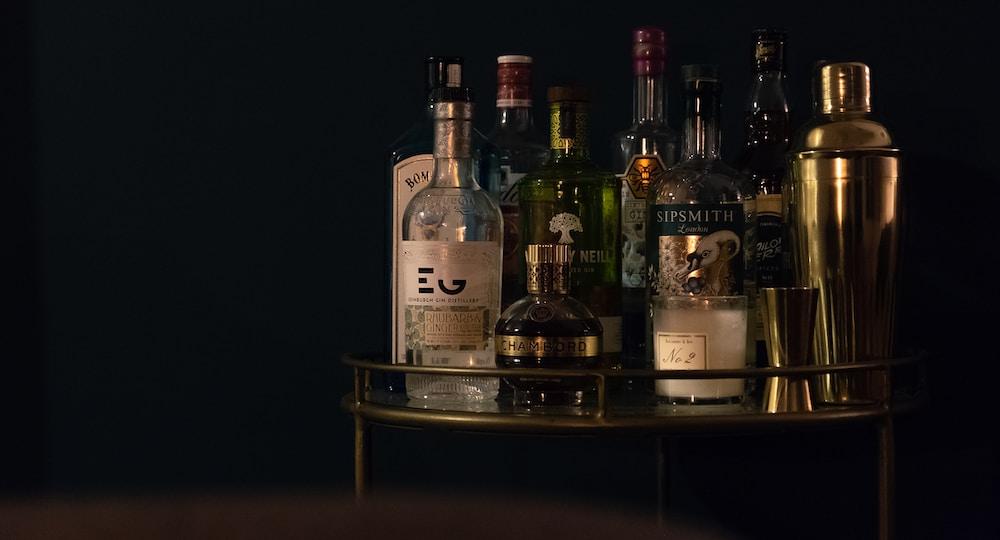 assorted glass liquor bottles