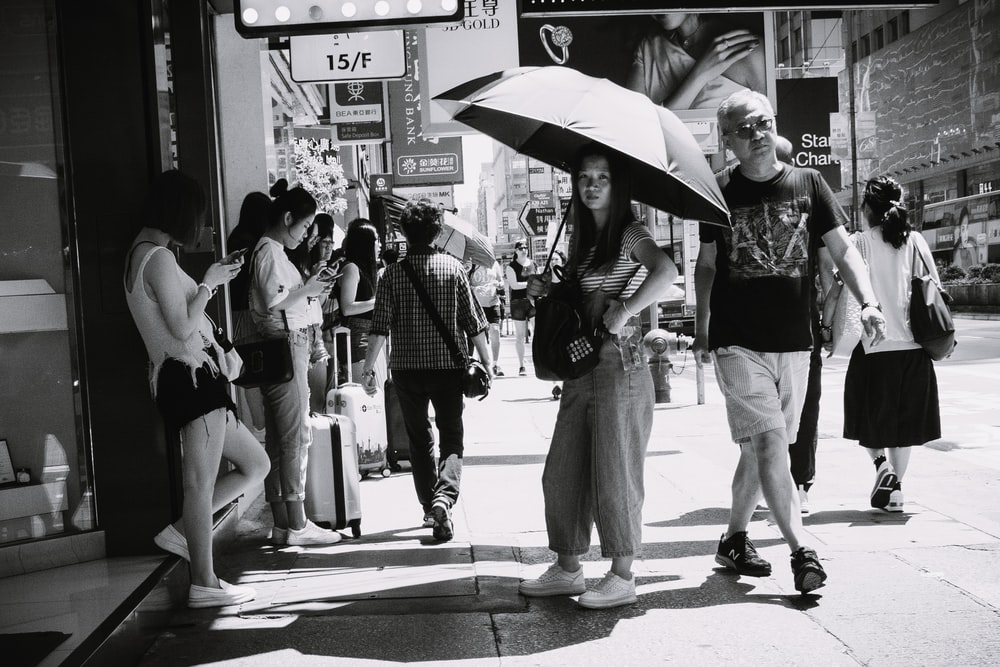 grayscale photo of people in street