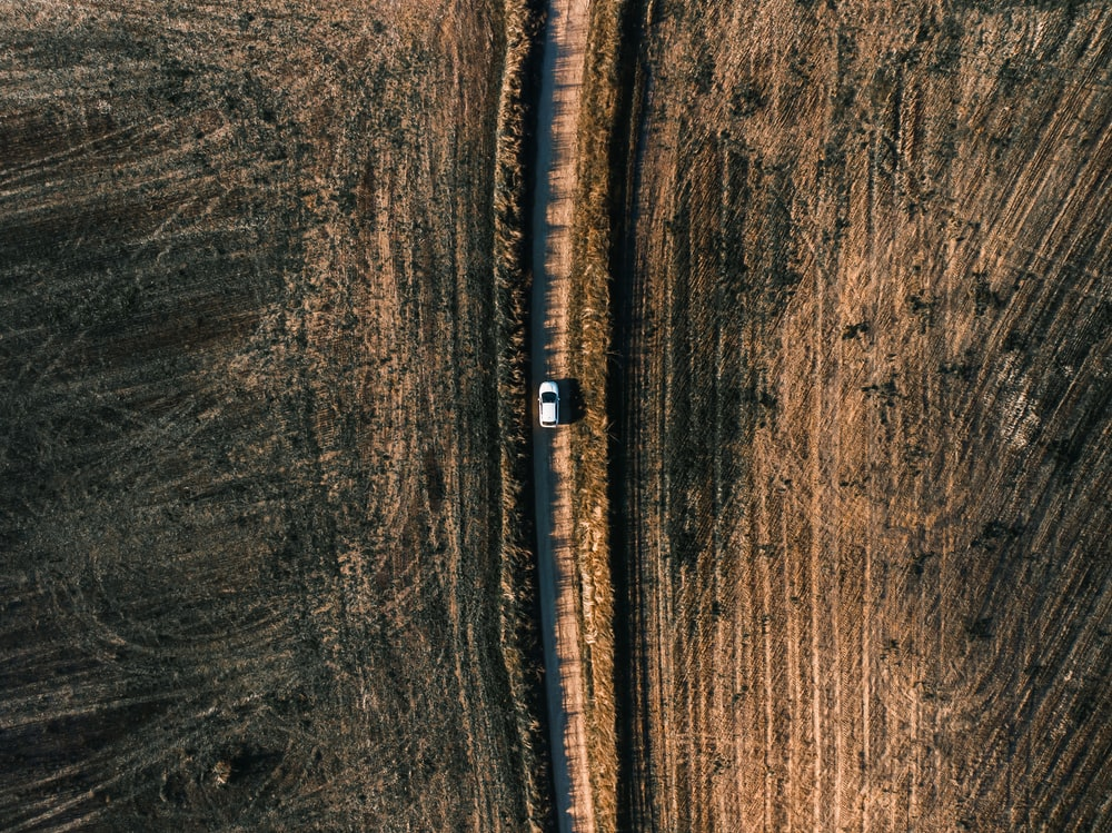 white vehicle on road in aerial photography