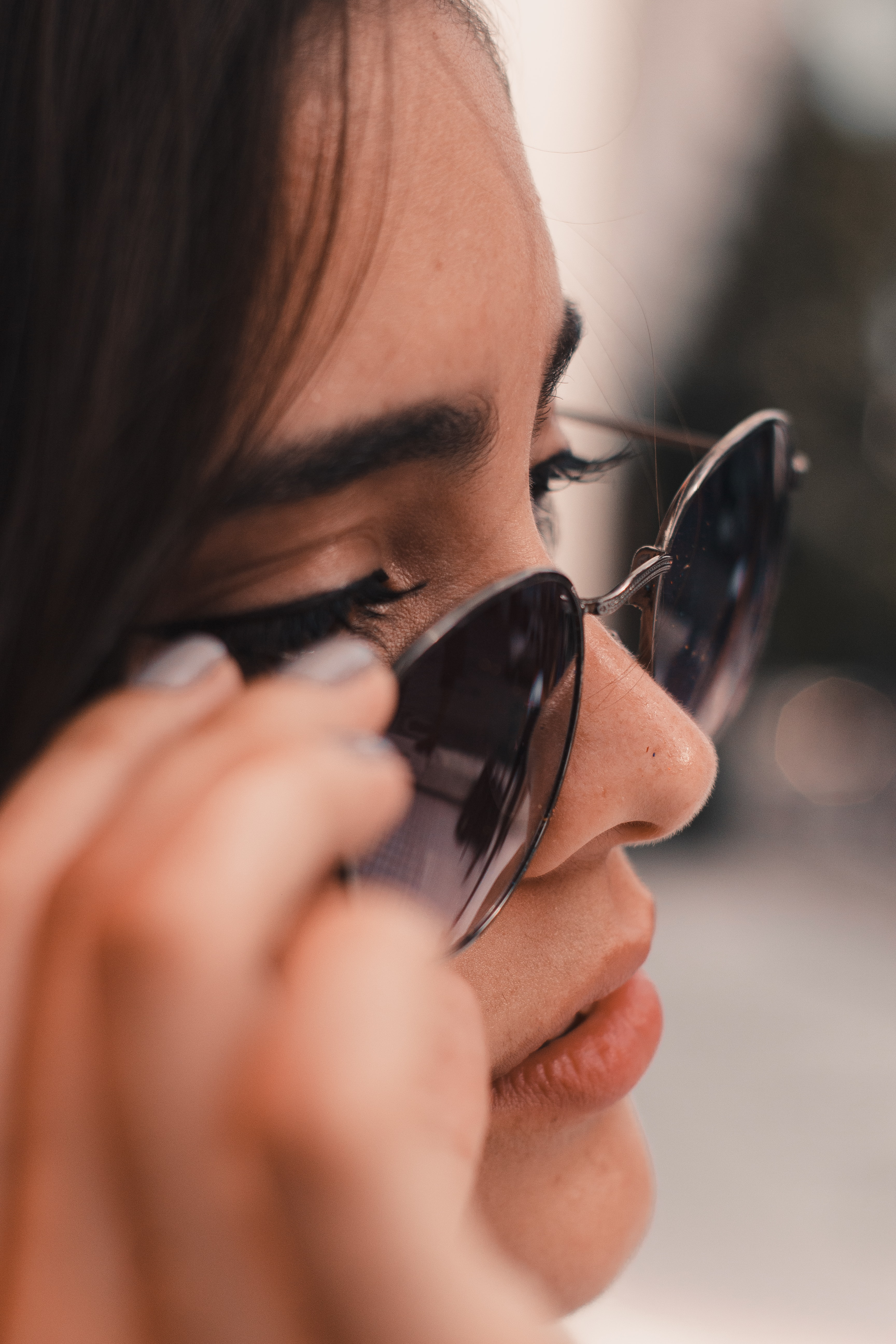 woman wearing gray framed sunglasses