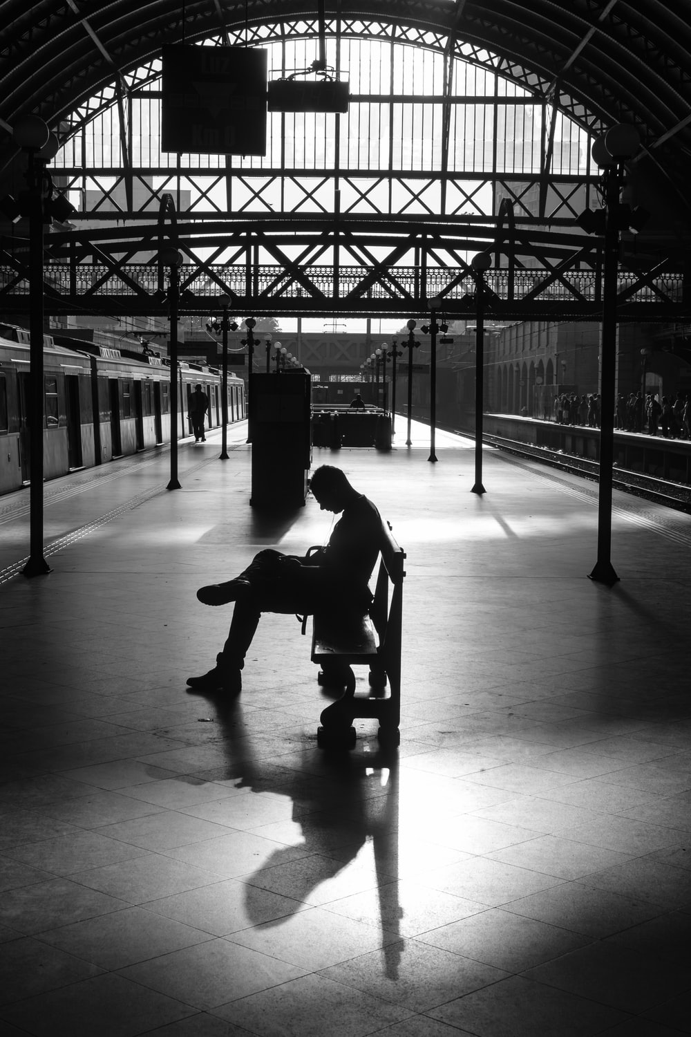 silhouette photography of person sitting on bench