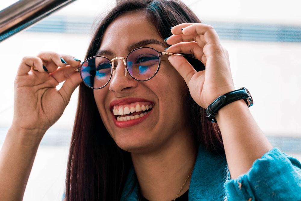 woman wearing eyeglasses with black frame