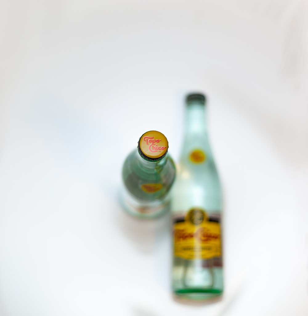 two green-and-yellow labeled bottles