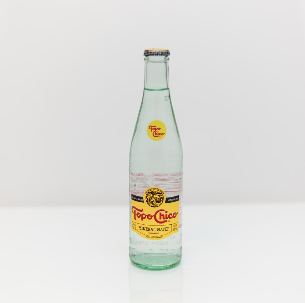 Topo Chico bottle on white surface