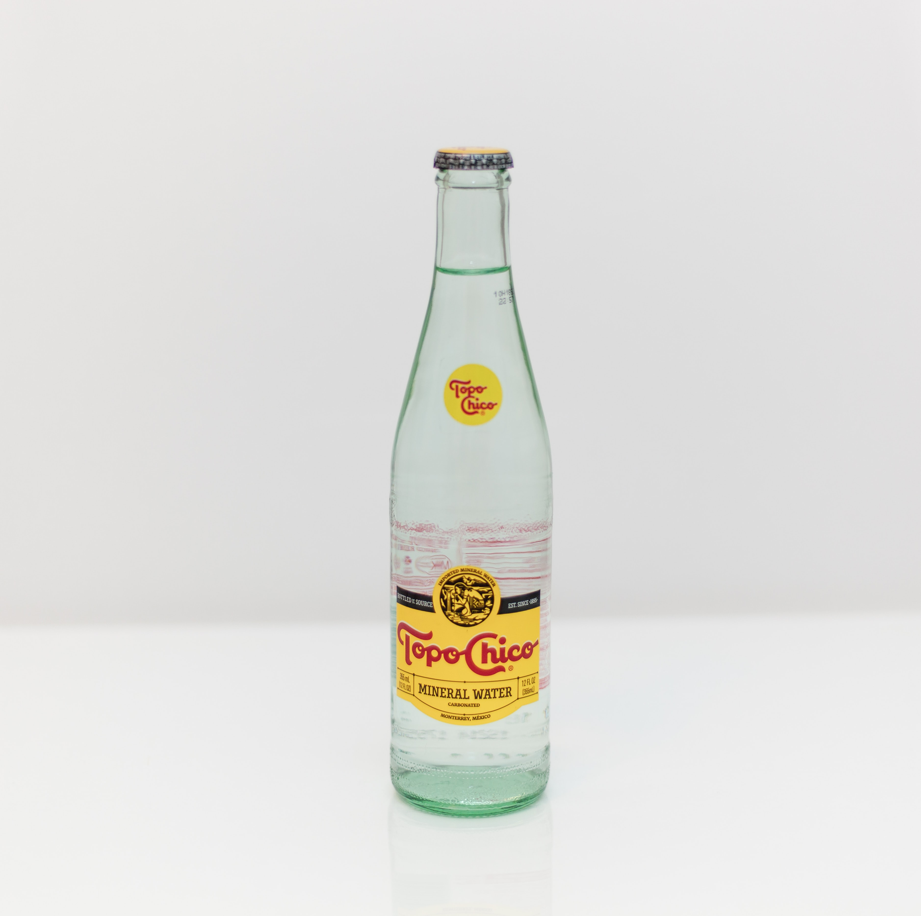 Topo Chico bottle on white surface