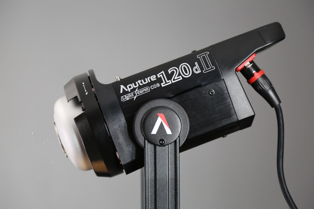 black Aputure 120d II corded electronic device