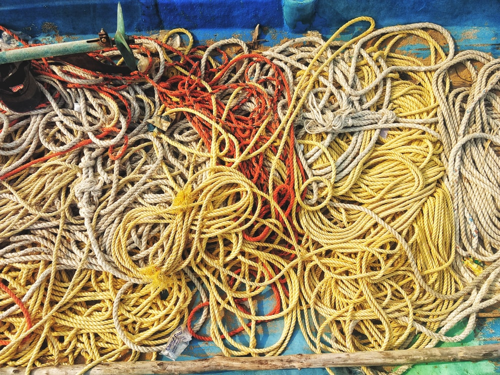 assorted-color ropes on blue surface