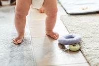 standing baby wearing diaper