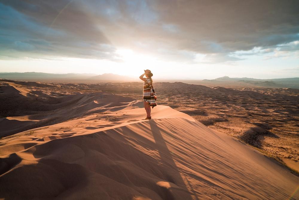 woman standing in desert