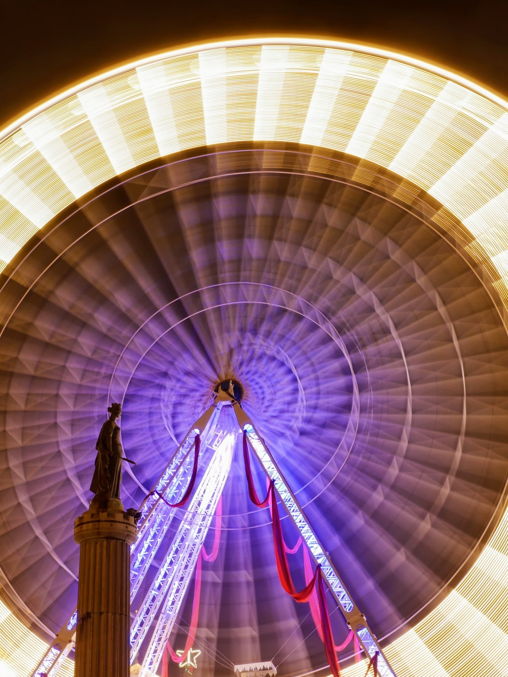 lighted ferris wheel in motion time lapse photo
