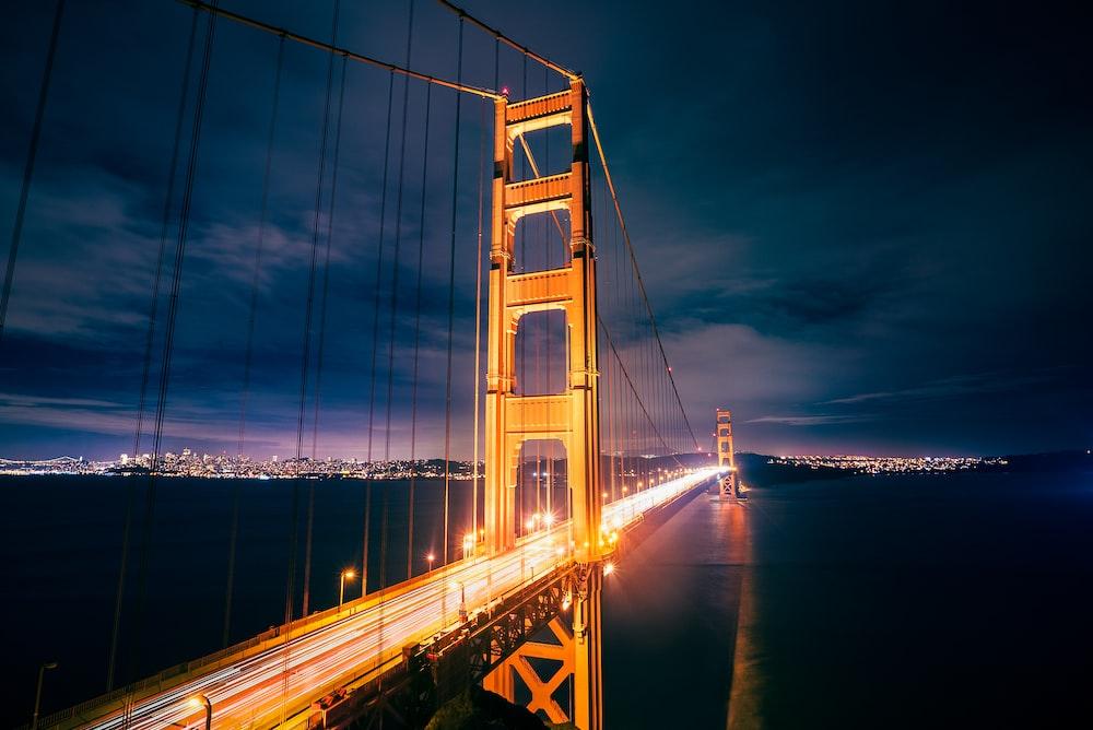 lighted Golden Gate Bridge during night