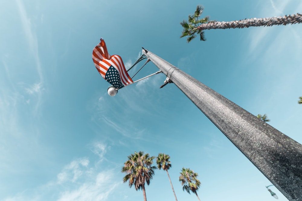 american flag flying on pole low angle photo