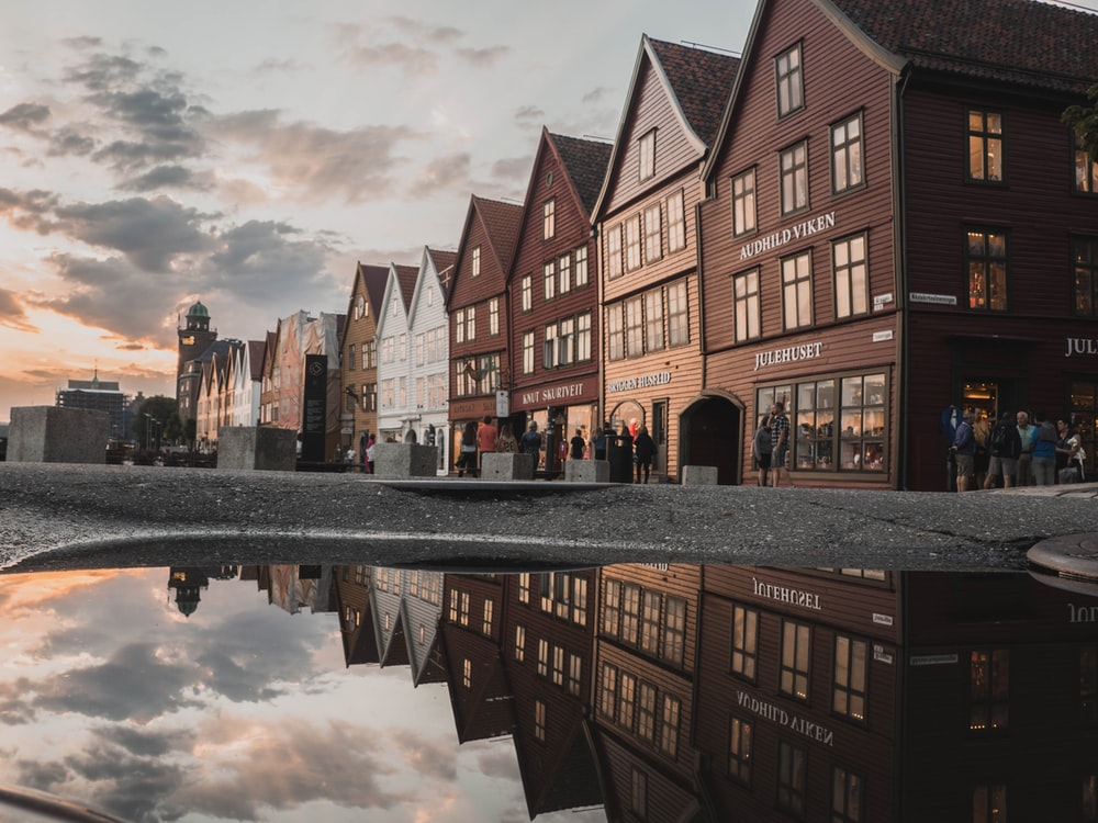 photo of houses with reflection on body of water
