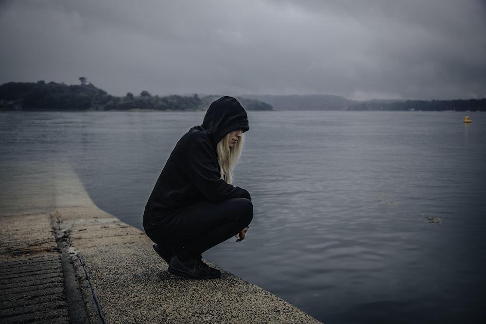 woman almost sitting near seashore