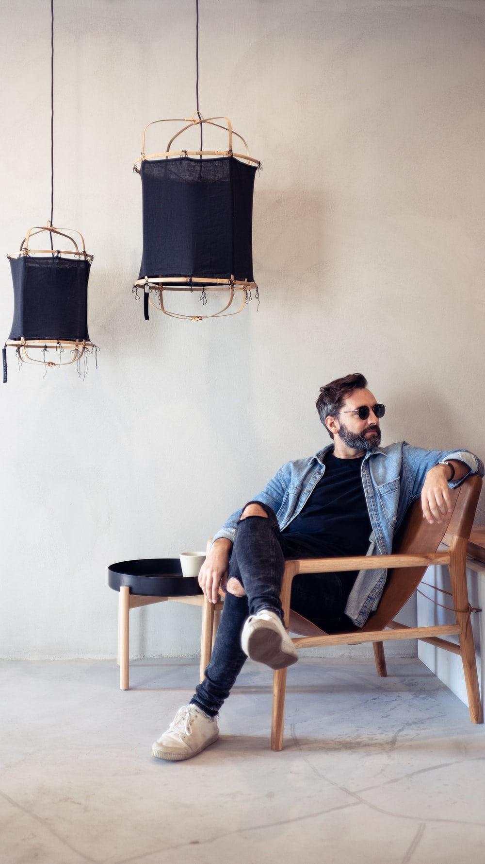 man sitting on brown armchair