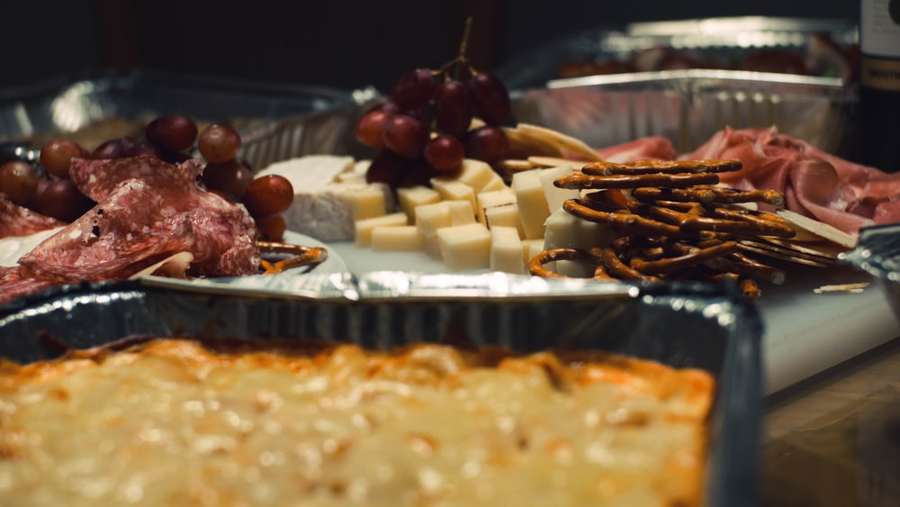 pretzels beside cheese on plate
