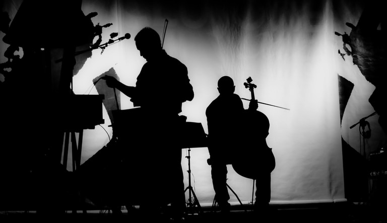 silhouette of musicians playing