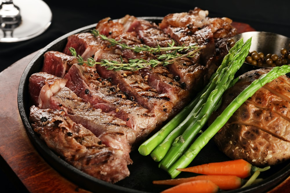 cooked meat on tray