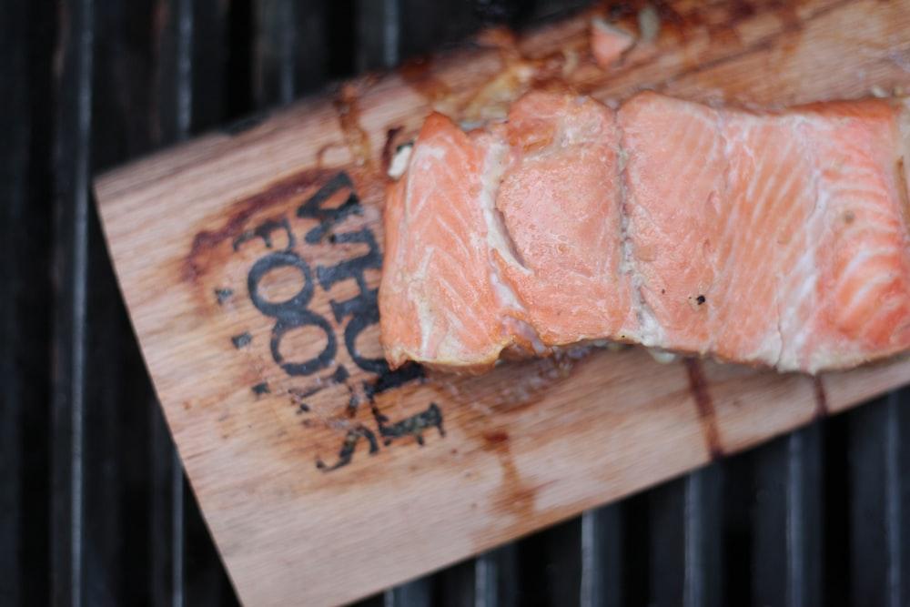 sliced salmon meat on board