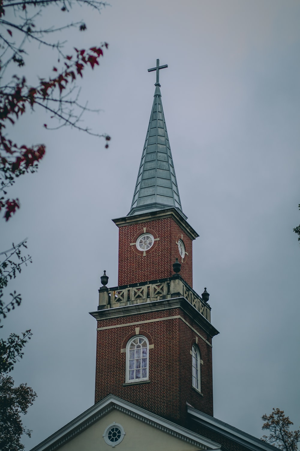 low angle photography of brown church