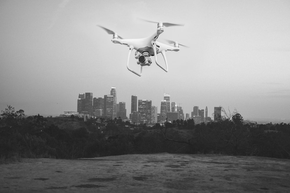grayscale photography of drone near body of water
