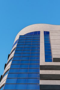 low-angle photography of gray and blue concrete building
